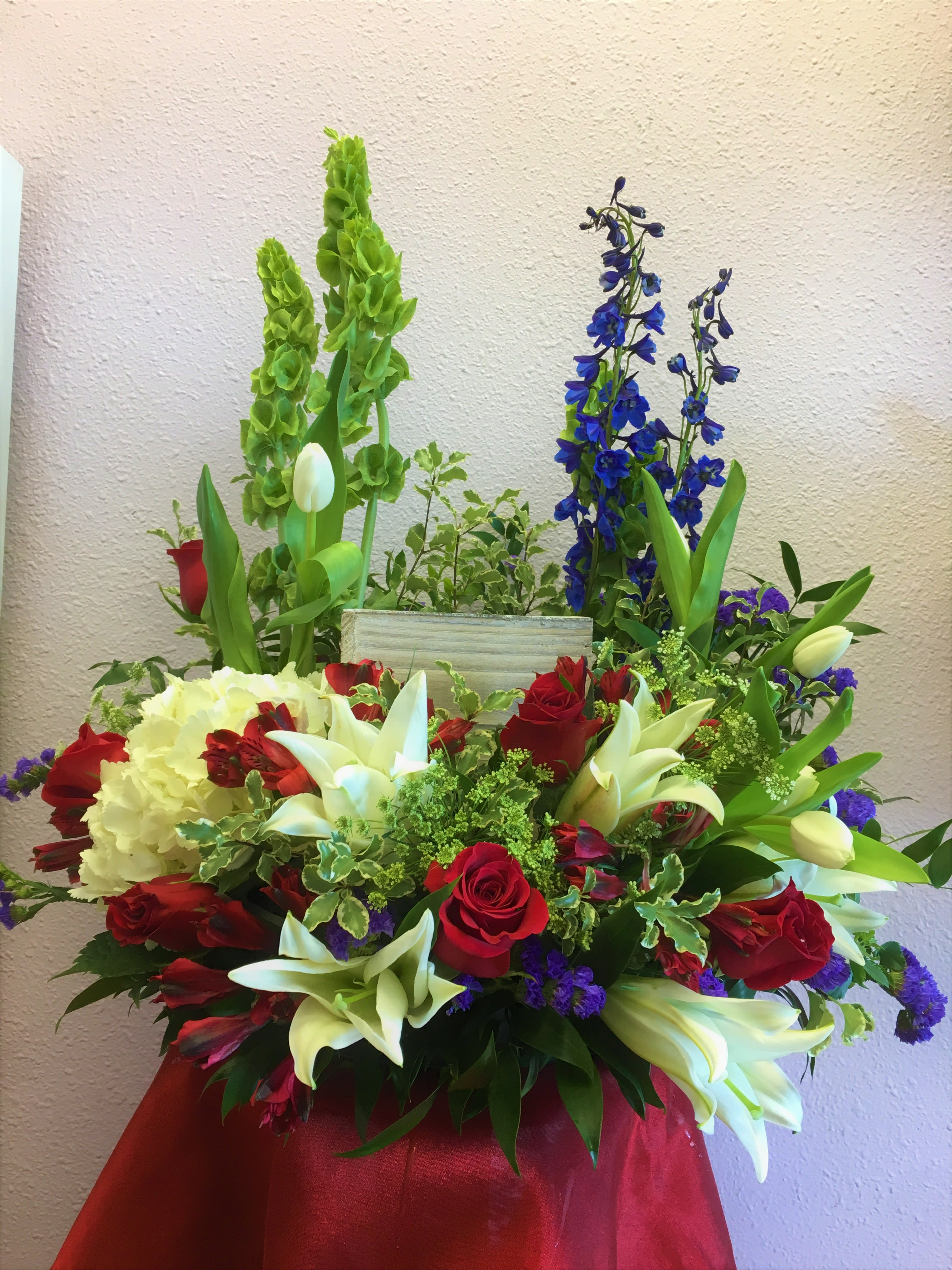 Bed Of Flowers Urn Arrangement by Forever Flowers