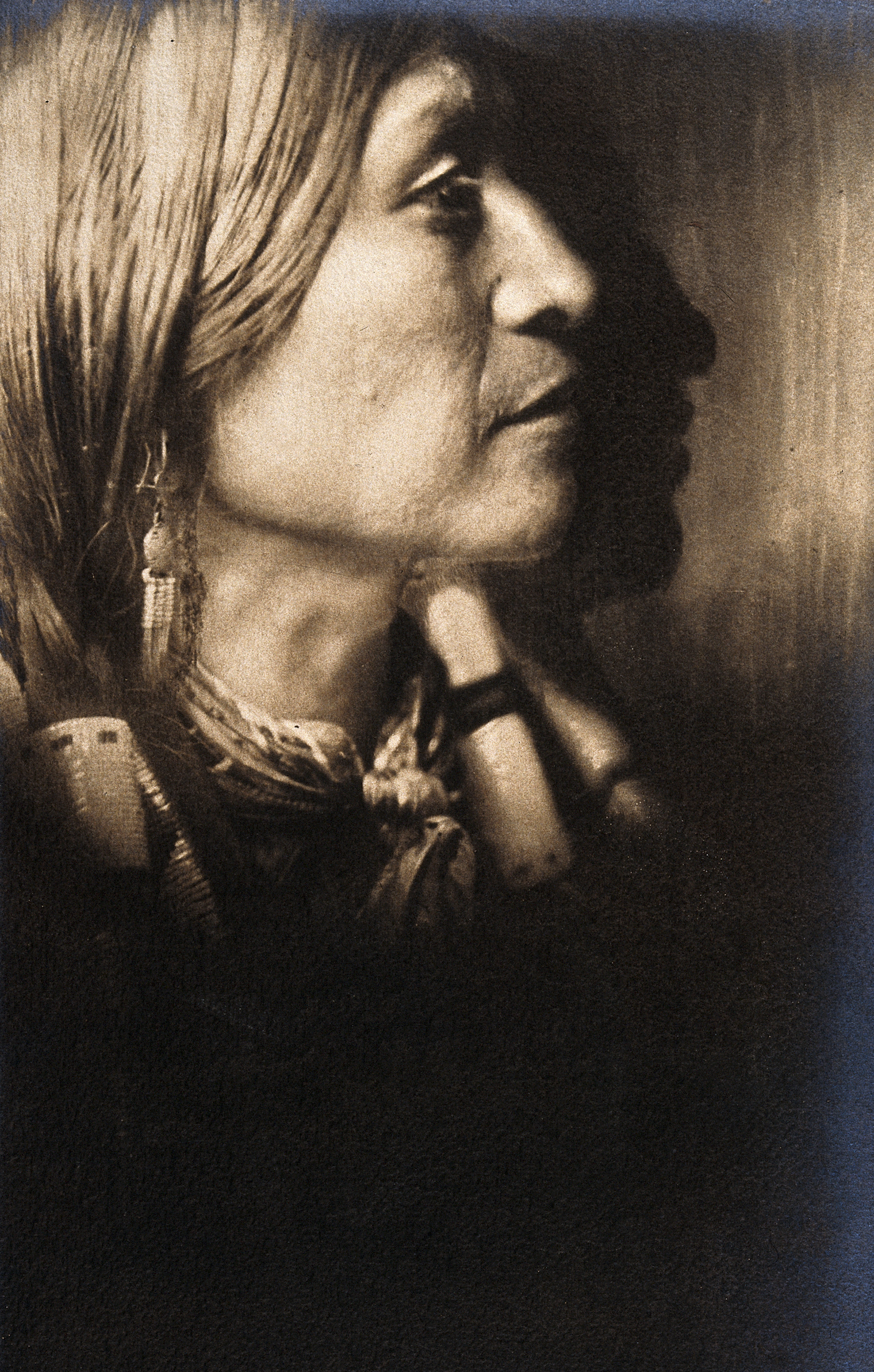 This photograph shows a Jicarilla Indian Chief in ceremonial dress.