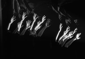CIRCA 1950s: Montage of outstretched arms.