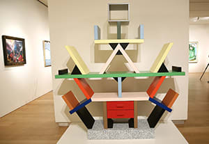 An Ettore Sottsass 'Carlton' bookcase, 1981, is on display