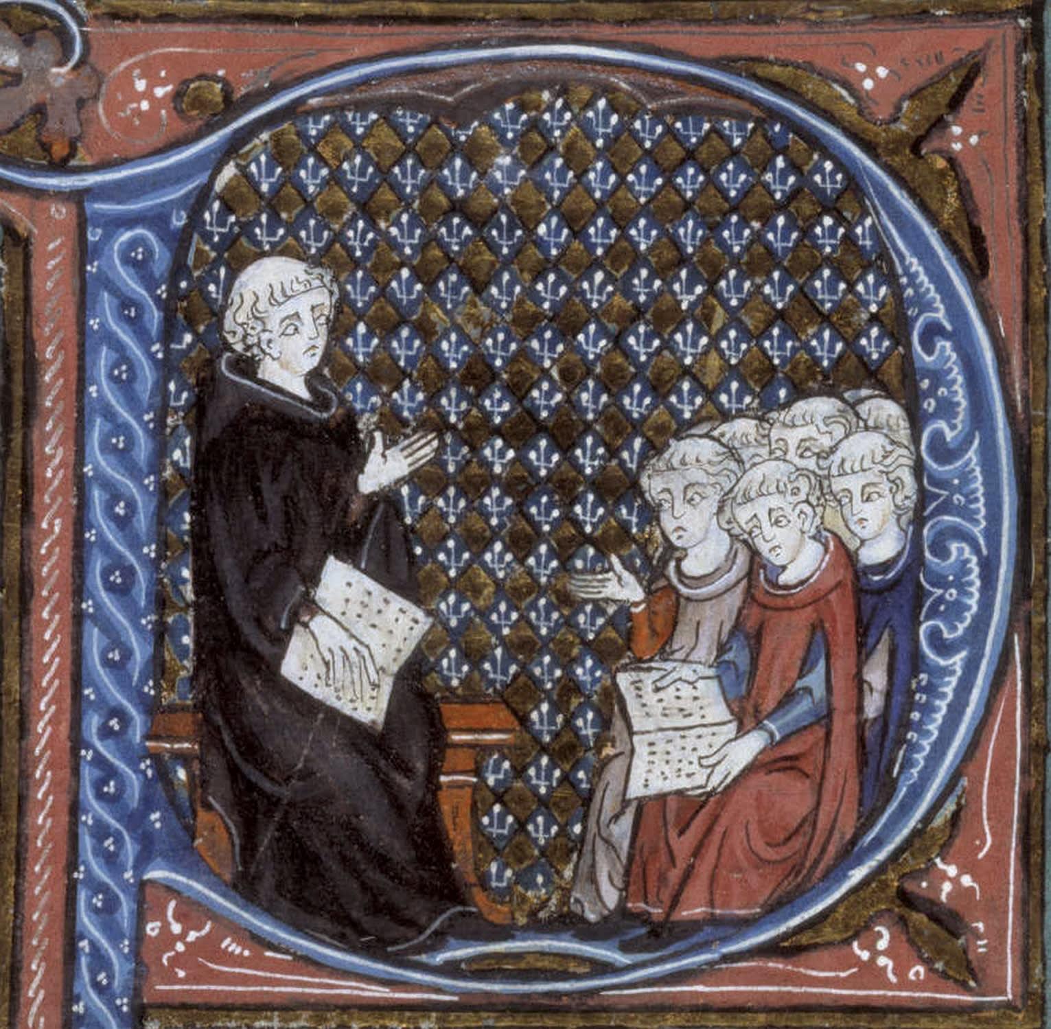 This image shows the The initial P showing a monk talking to a group of pupils.