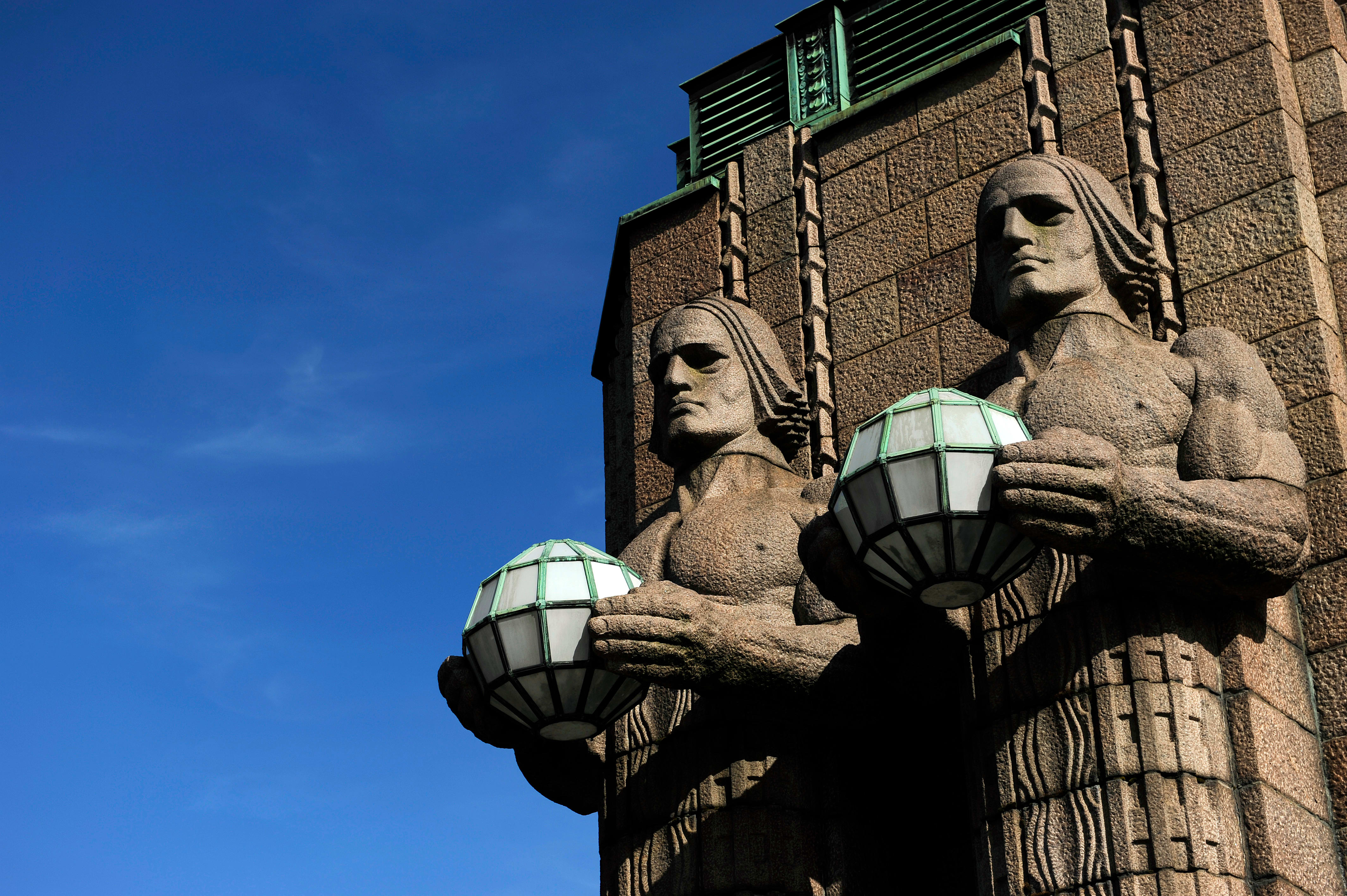 Image of the famous modernist torchbearer lamps at Helsinki Railway Station, Finland © Getty / PHAS / contributor