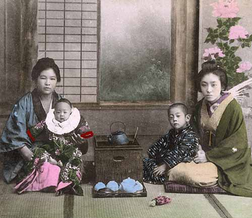 Japan - Japanese Women pose for a photogrpah with babies