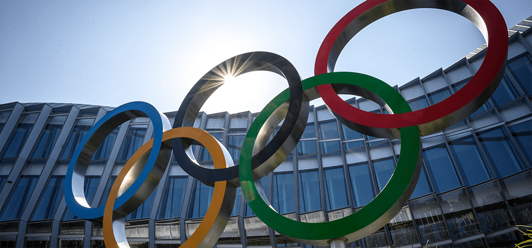 The Olympic Rings logo pictured in front of the International Olympic Committee headquarters