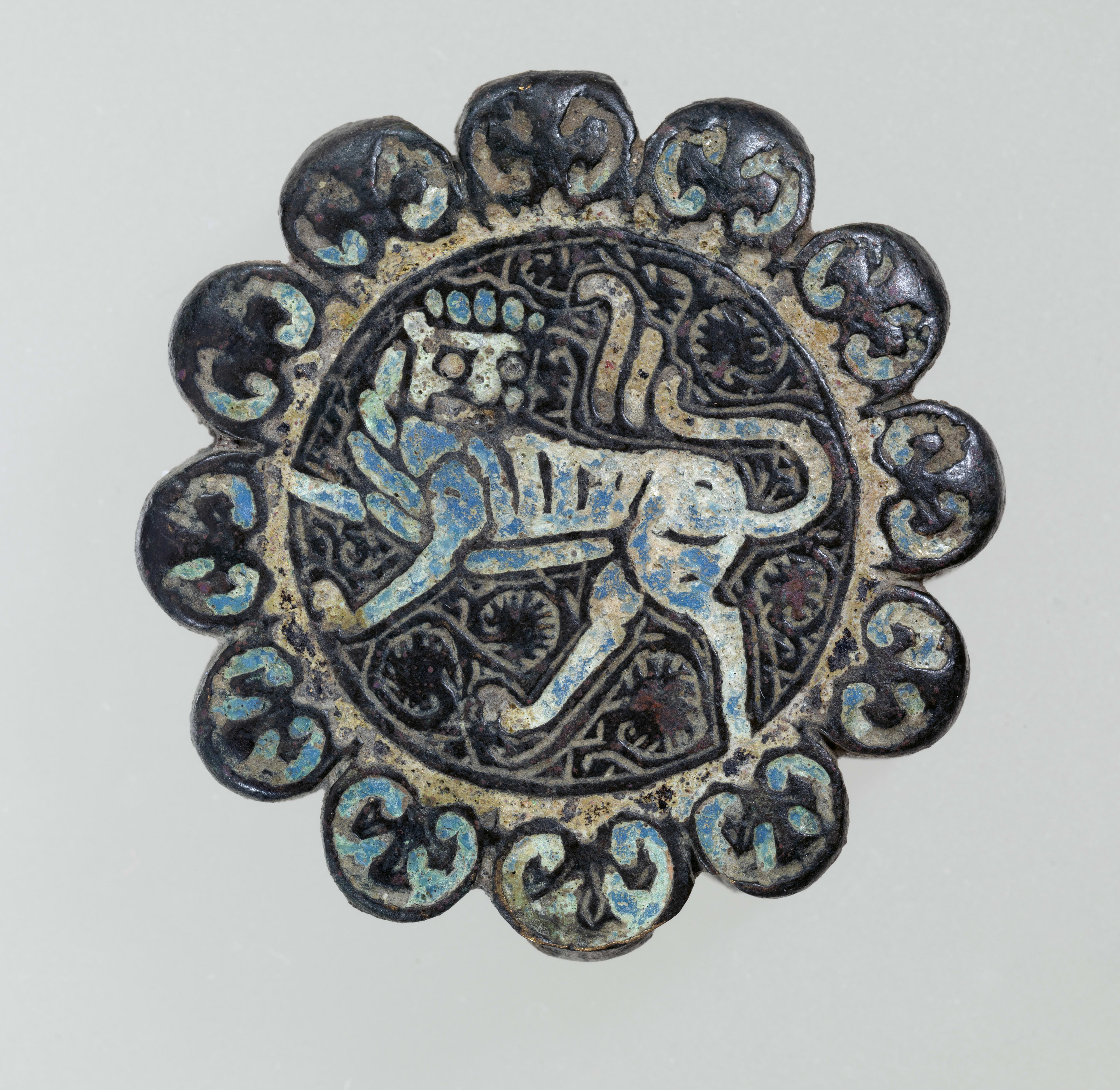This is an image shows a silk and metallic embroidered badge or patch.