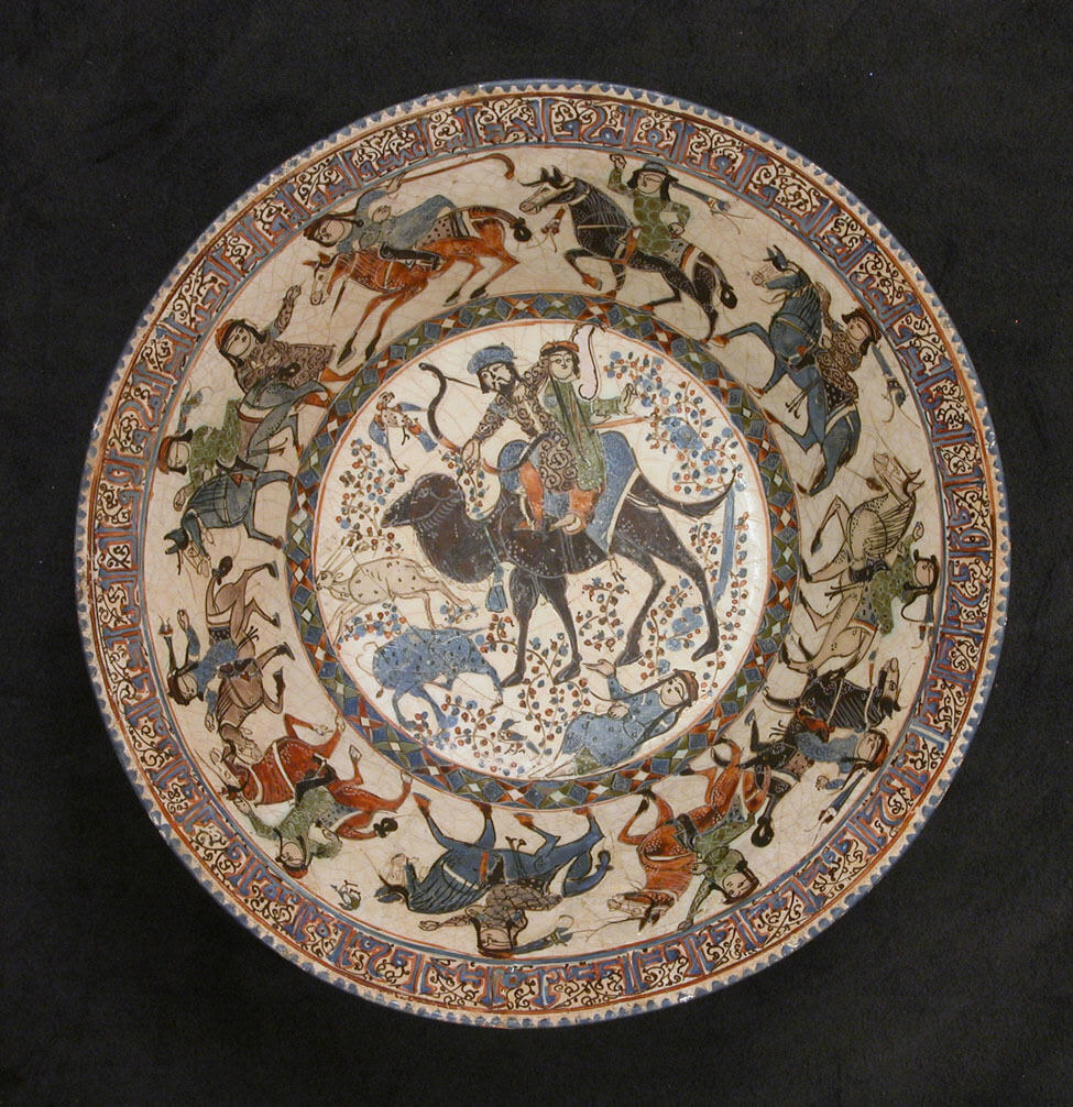 This is showing a stonepaste bowl decorated with human figures and animals.