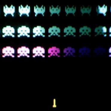 A classic video game 'Space Invaders' is displayed at the Science Museum in London.