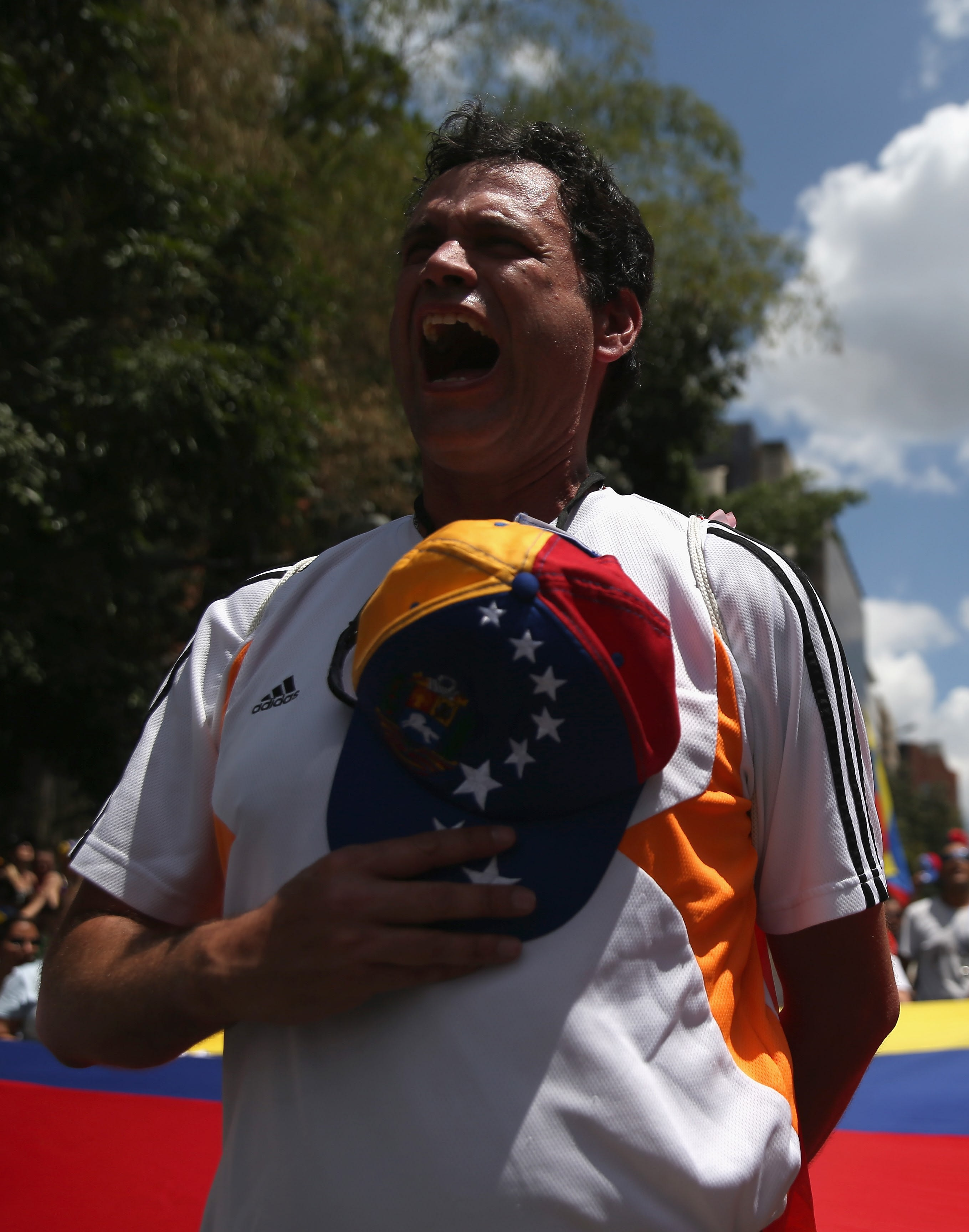 Protesters sing the Venezuelan national anthem during an anti-government demonstration, 2014 (Getty Images)