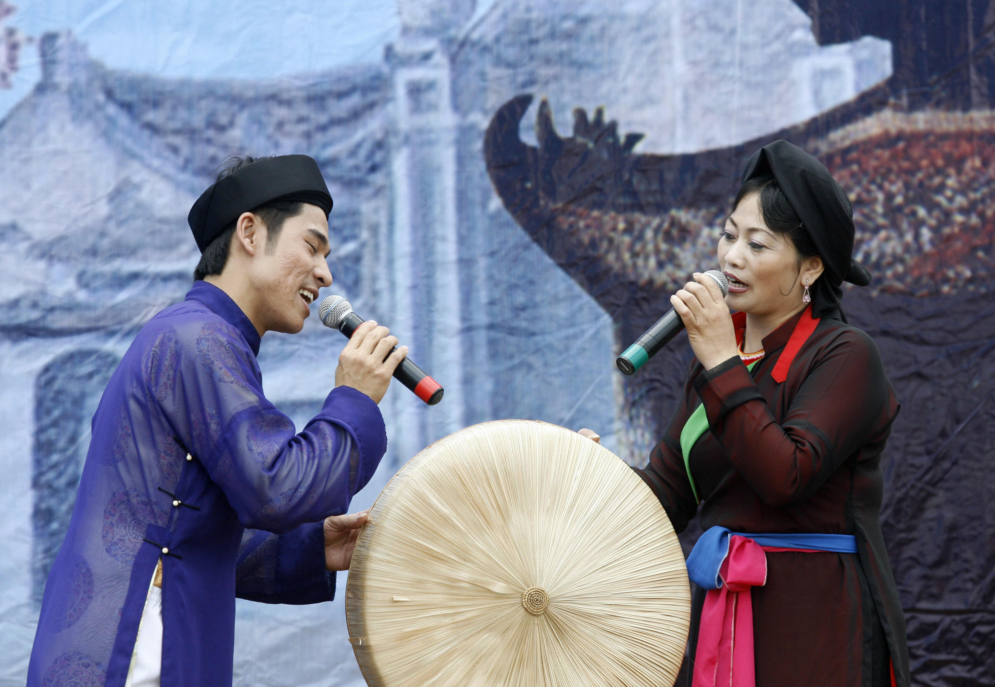 Two Quan Ho folk singers perform a love song during the Lim festival, Northern Vietnam