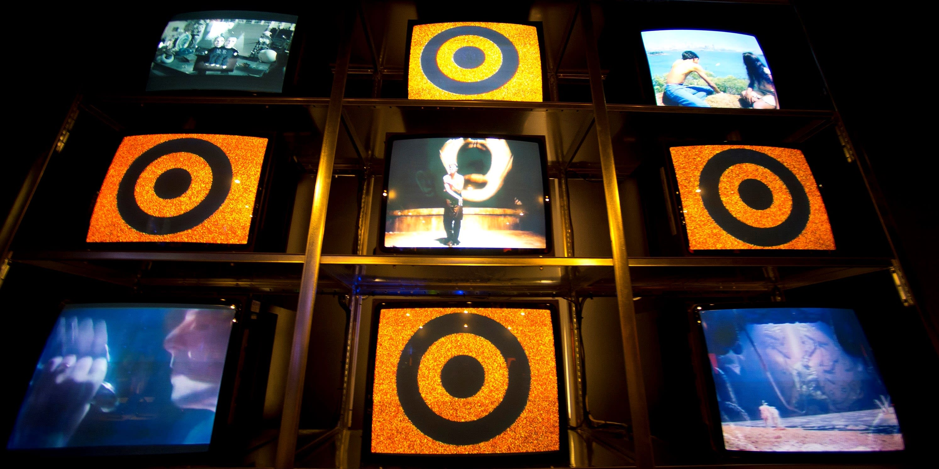 A television display plays David Bowie music videos at the 'David Bowie Is' exhibition at the Victoria & Albert Museum, 2013 (Ben A. Pruchnie/Getty Images)