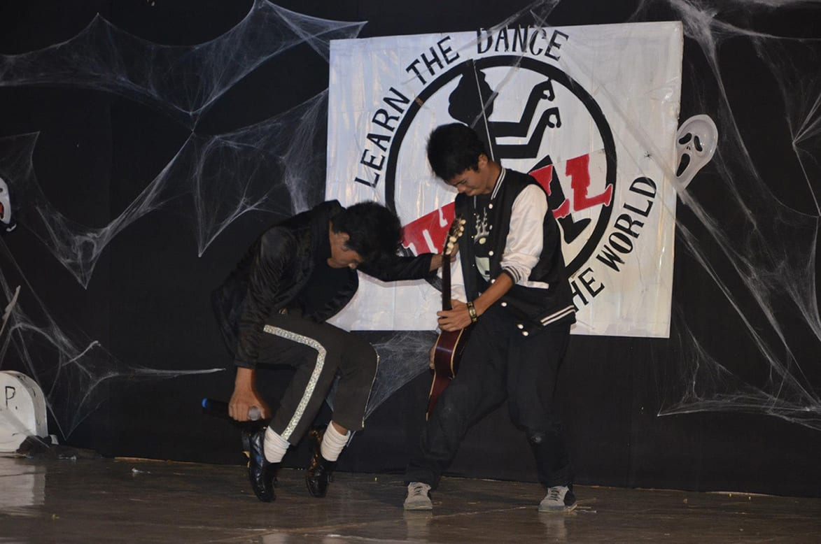 Two participants battle it out in the Michael Jackson Dance-Off, Thrill the World 2012, Marikina, Metro Manila