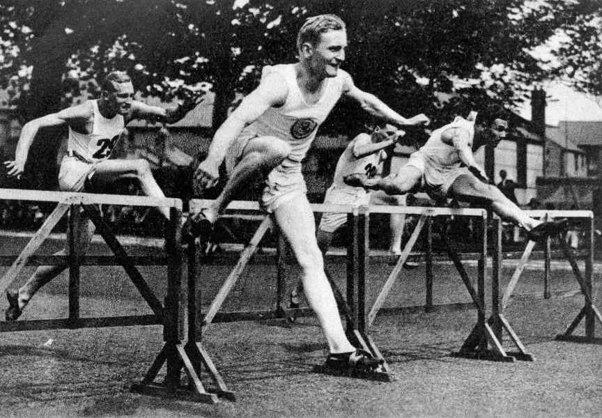 This photograph of hurdlers in action shows the correct style of running.