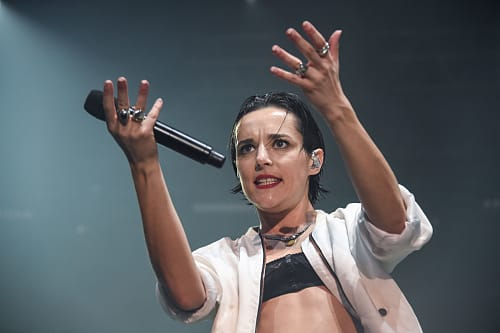French singer from indie band Savages, Jehnny Beth (whose real name is Camille Berthomier) performs on stage during the 29th Eurockeennes rock music festival on July 9, 2017 in Belfort, eastern France.