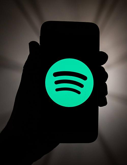 Spotify logo displayed on a phone screen (Porzycki/NurPhoto via Getty Images)