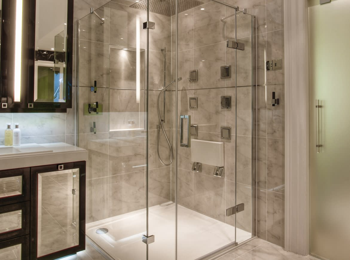 The floor next to a shower is often a slick area. Light fixtures directed to this area could help to alert someone to a slippery surface.