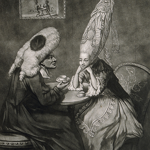 In this image, a woman wearing an extraordinarily high wig decorated with beads and lace, discusses her head-dress with a man sitting opposite who wears a legal tie wig, gown and bands.