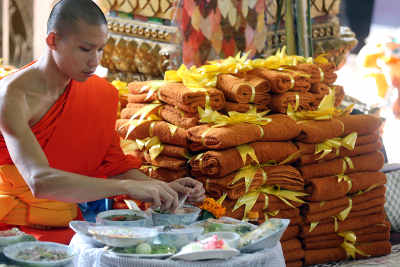 Wat Si Muang (Simuong) buddhist temple. Buddhist monks having vegetarian lunch in monastery. Vientiane, Laos..