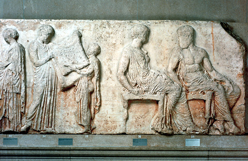 Roman civilization, relief portraying woman and child at feast, servant bringing plate laden with food.