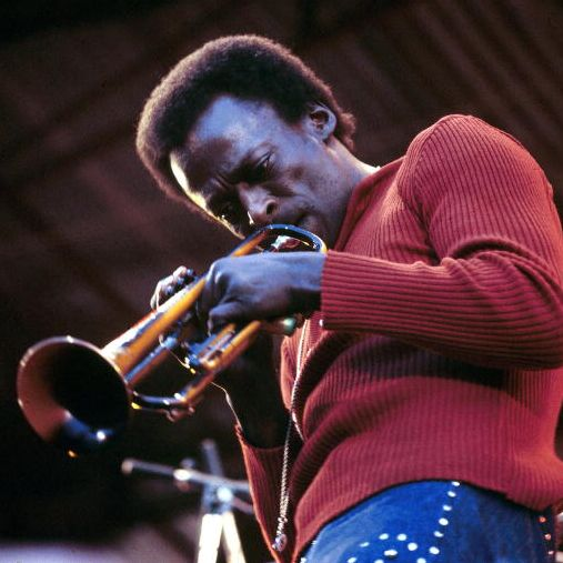 Miles Davis playing trumpet on stage in 1970
