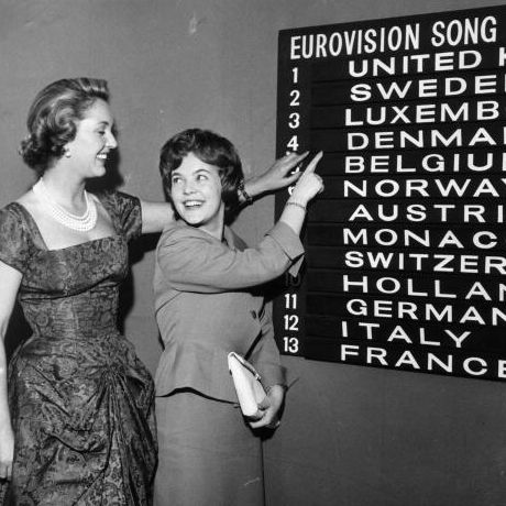 Eurovision Song Contest compere Katie Boyle (on the left) checks the scoreboard for the order of the draw with Katy Bodtger of Denmark. (Photo by Keystone/Getty Images)