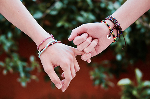 Two hands linking