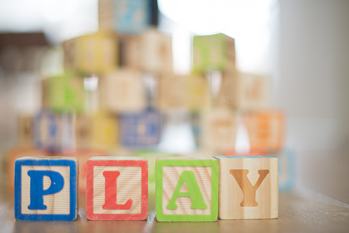 Wooden letters spelling 'Play'