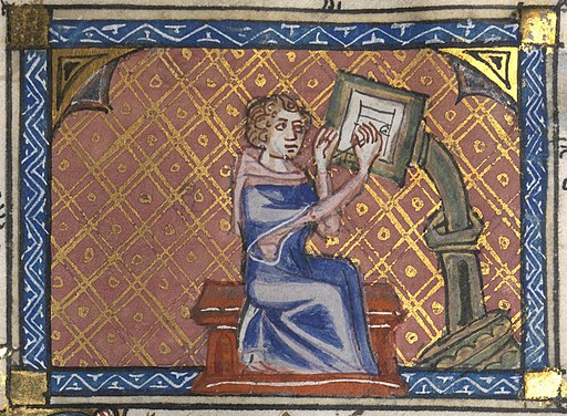 Image showing an author writing at his desk