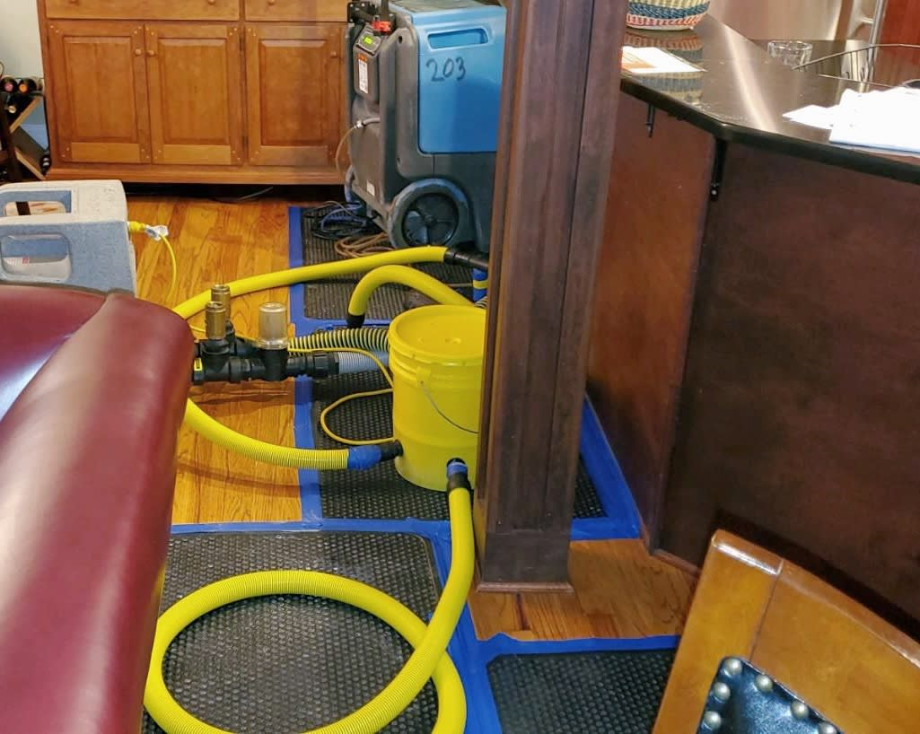 Blue Chip Drying Mat System extracting water from hardwood floors