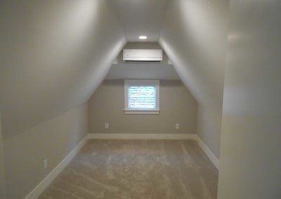Guest bedroom renovated with new carpet after a fire damage