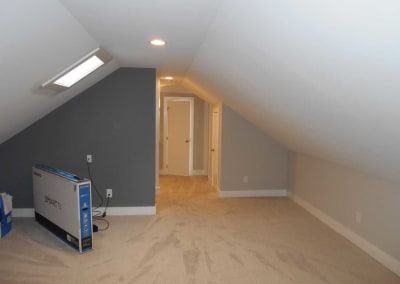 Renovated bonus room with new carpet and being damaged by fire