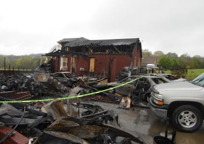 Front of a red brick house destroyed by a fire