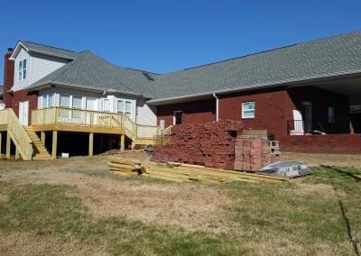 Brick garage carport and wood deck that were rebuilt by Blue Chip Restoration after a fire destroyed them