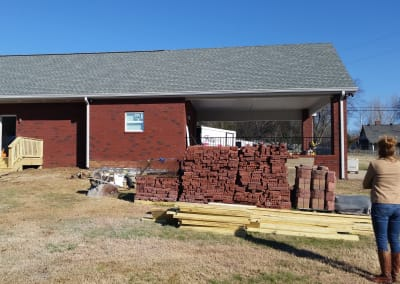 Blue Chip Restoration inspects a rebuilt brick garage and carport after a fire destroyed it