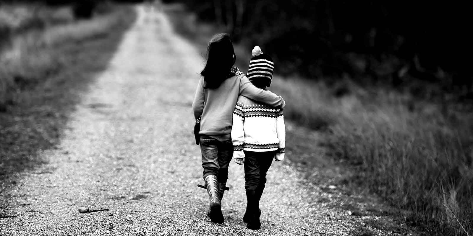 2 Kids Walking On Road
