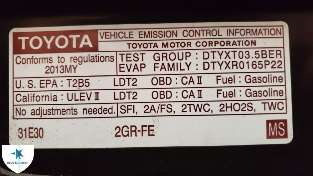 The Vehicle Emission Control label (VECI) was present underhood.