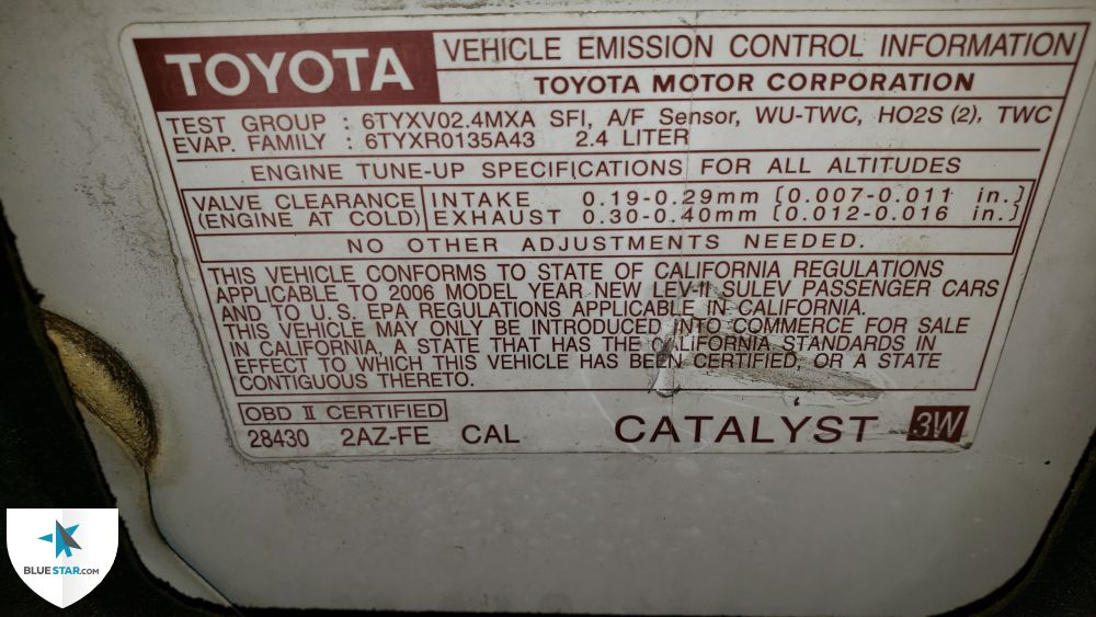 Vehicle Emission Control Information (VECI) label is present under the hood.