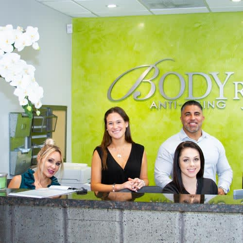 bodyrx coral gables staff at front desk smiling