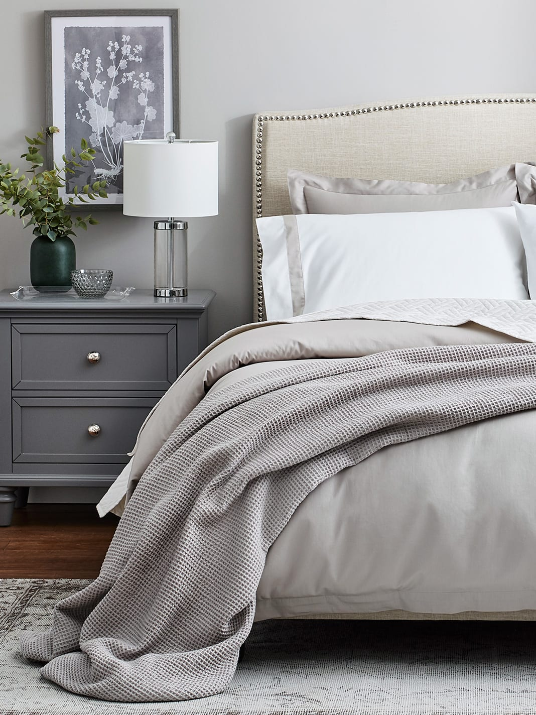 Waffle bed blanket by Boll & Branch in the color pewter.