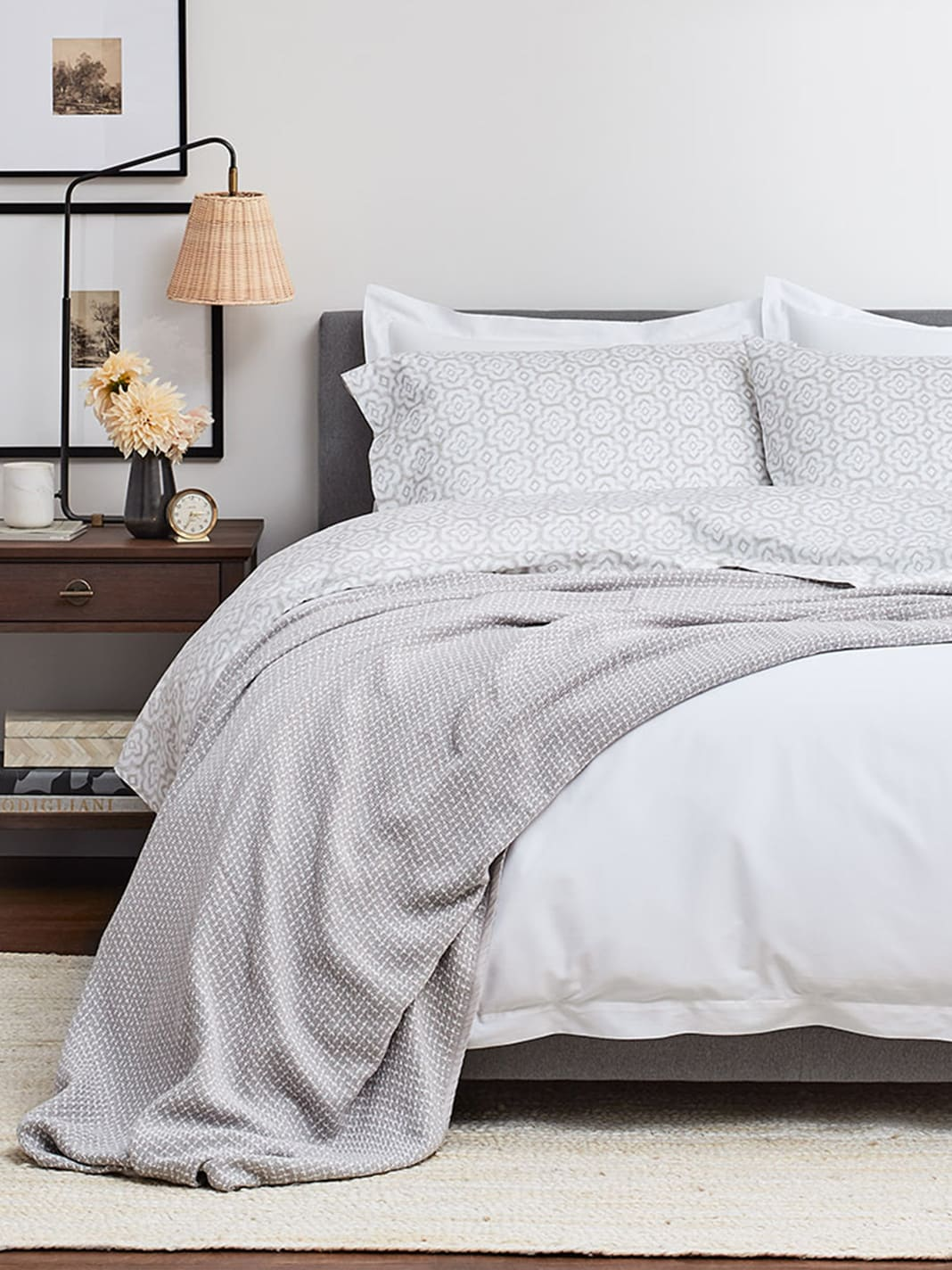 Gorgeous light grey Pickstitch blanket (Pewter) from Boll & Branch makes the perfect subtle accent in a tranquil bedroom. #bedroomdecor #bedding #blankets #pickstitch #bollandbranch
