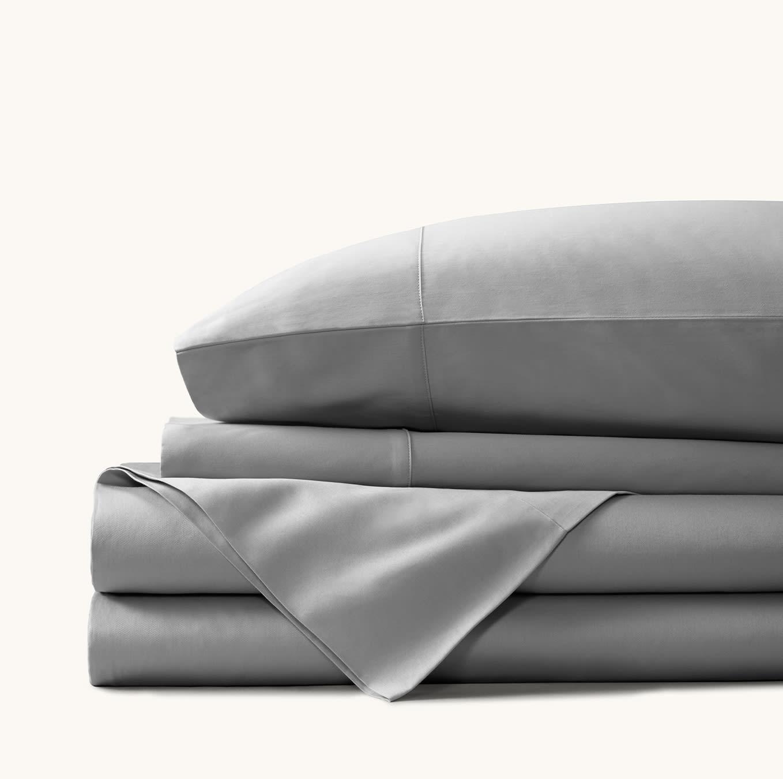 grey sheets and dark grey bedding