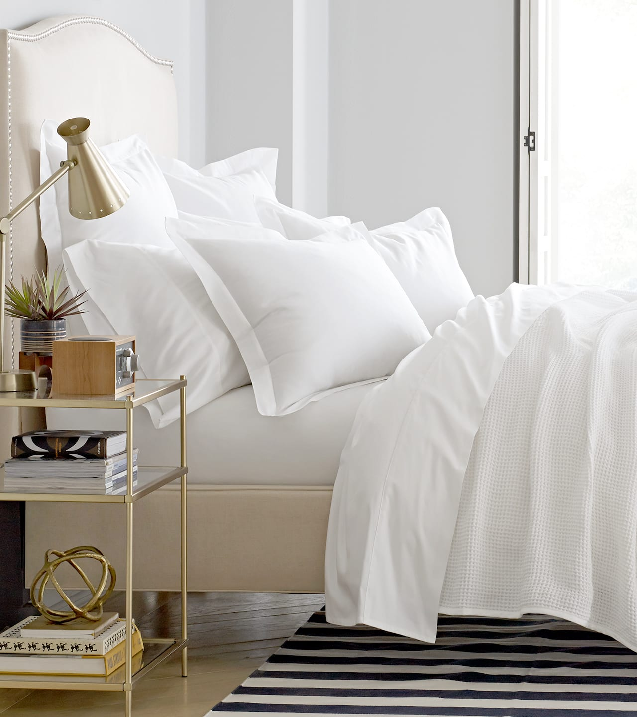 Side Image of a bed with white sheeting