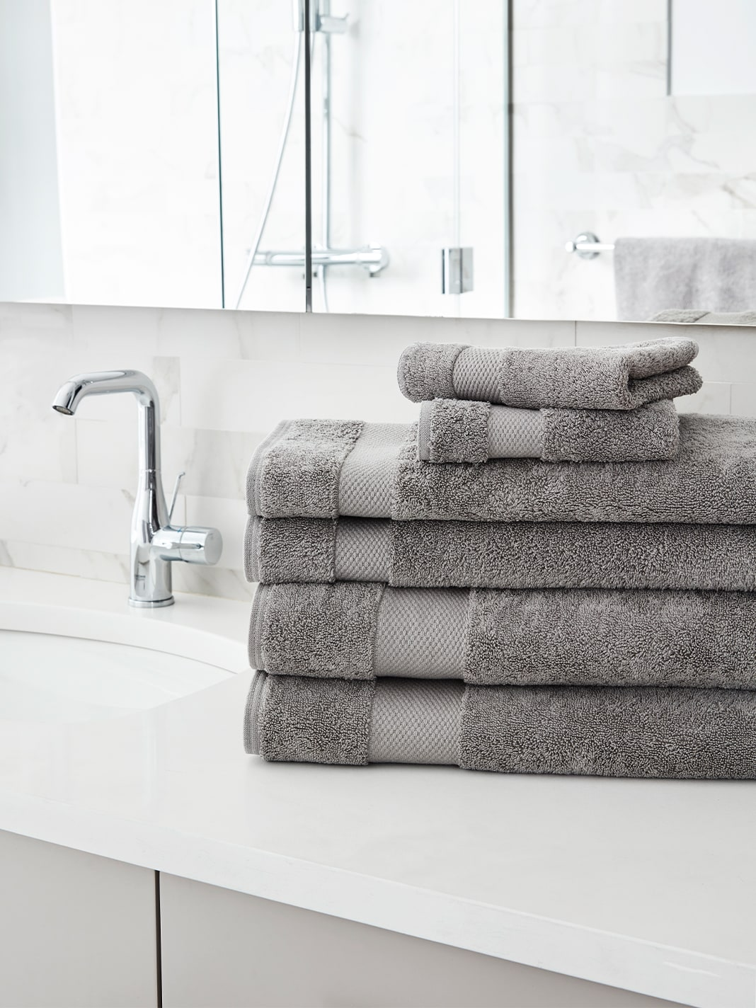 Gorgeous grey towel set from Boll & Branch in stone color. #greytowels #bathtowels #bathrooms #spatowels