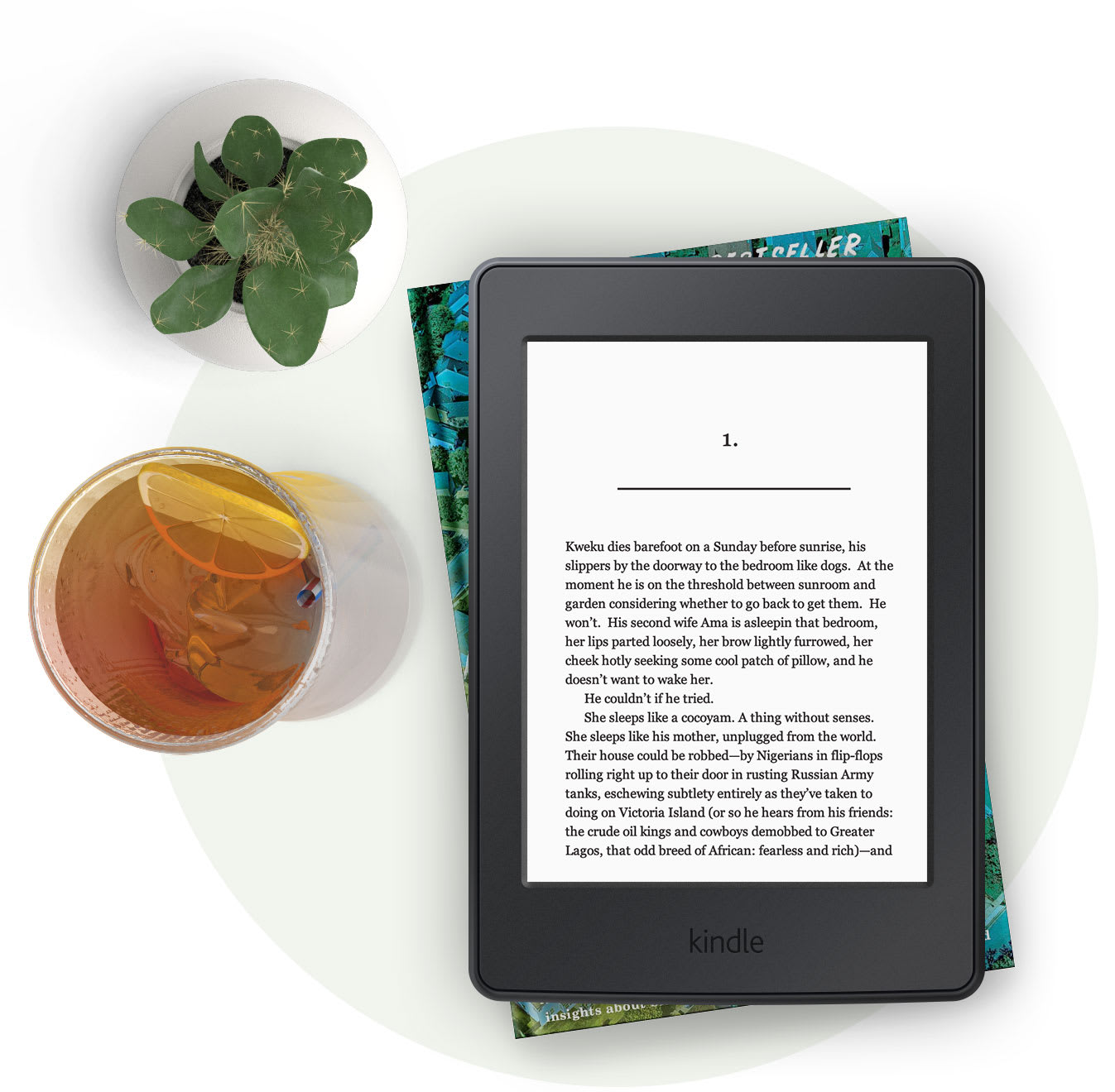 Kindle e-reader with a glass of iced tea