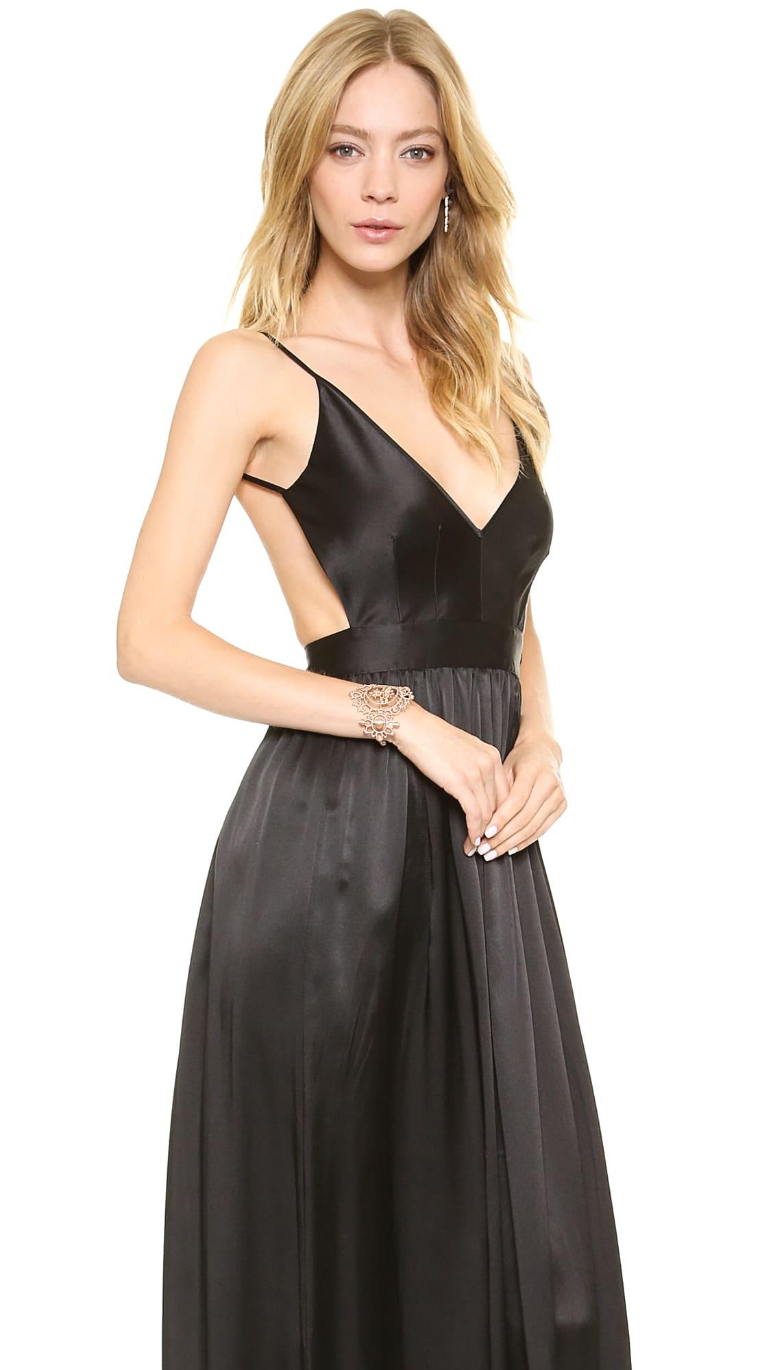 ed25b59e3 Contrarian1. Contrarian3. Contrarian4. Previous Next. This long silk dress  features a deep V neck ...