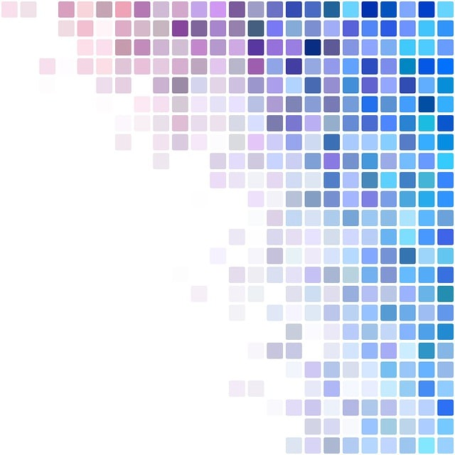 On a white square are gradually designed several pixels in shades of blue, above the diagonal