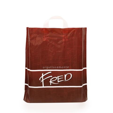 Bolsa biodegradable impresa con diseño y logo de la marca Fred.