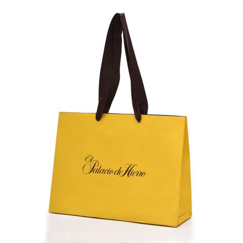 Bolsa de papel kraft impresa en amarillo El Palacio de Hierro.