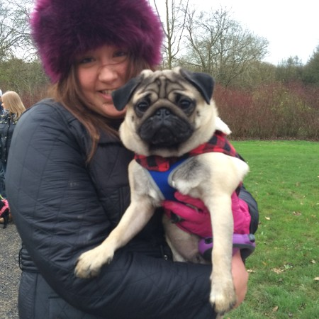 A woman and a pug