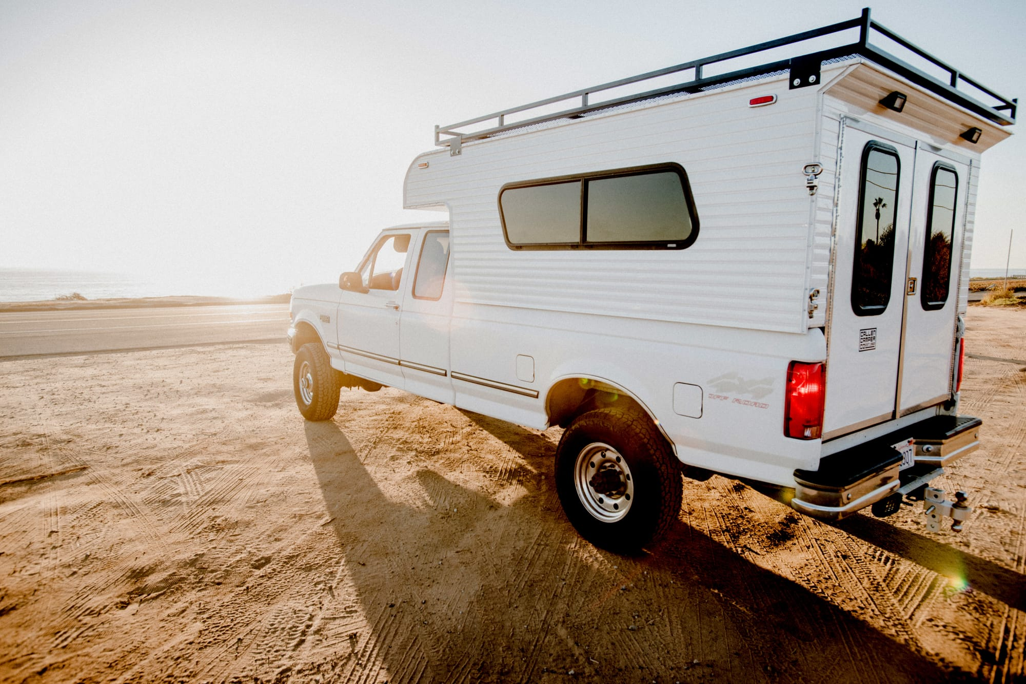 A Custom Callen Camper parked out by the beach in Southern California