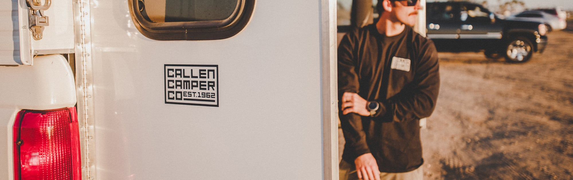 Rear camper barn door with Callen Camper sticker